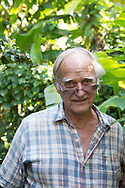 John Criswick, owner of the St. Rose Nursery where he sells a vast array of tropical plants. La Mode, St. George's, Grenada, West Indies, Caribbean