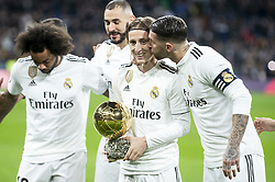 December 15, 2018 - Madrid, Spain - Luka Modric of Real Madrid receive the golden ball and pose with his partners Marcelo,Karim Benzema and Sergio Ramos during La Liga match between Real Madrid and Rayo Vallecano at Santiago Bernabeu Stadium in Madrid, Spain. December 15, 2018. (Credit Image: © Coolmedia/NurPhoto via ZUMA Press)