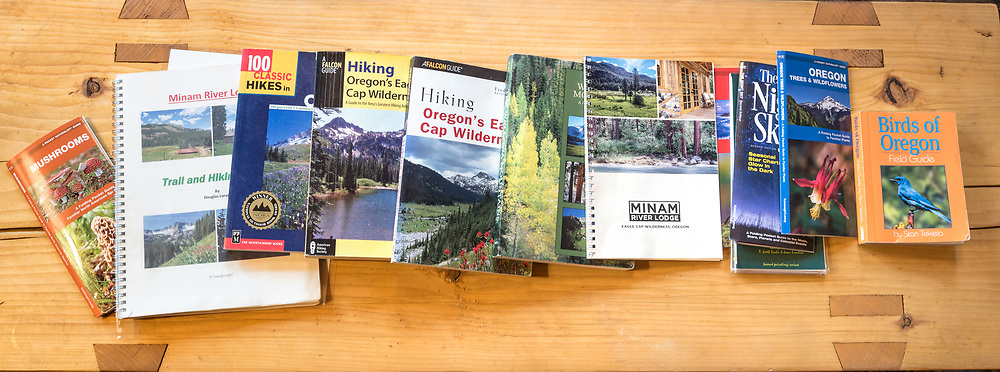 Books on a table in the Minam River Lodge, Oregon.