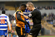 Referee Keith Hill checks on a dazed Nouha Dicko during the Sky Bet Championship match between Wolverhampton Wanderers and Reading at Molineux, Wolverhampton, England on 7 February 2015. Photo by Alan Franklin.