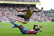 Pape N'Diaye Souare of Crystal Palace (on ground) fouls Alex Oxlade-Chamberlain of Arsenal. Barclays Premier league match, Crystal Palace v Arsenal at  Selhurst Park in London on Sunday 16th August 2015.<br /> pic by John Patrick Fletcher, Andrew Orchard sports photography.