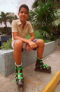 CUBA, HAVANA (HABANA VIEJA) Young Cuban boy with roller blades