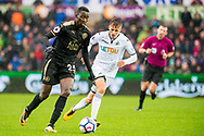 ( L-R ) Wilfred Ndidi of Leicester City and Tom Carroll of Swansea City in action. Premier league match, Swansea city v Leicester city at the Liberty Stadium in Swansea, South Wales on Saturday 21st October 2017.<br /> pic by Aled Llywelyn, Andrew Orchard sports photography.