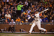 San Francisco Giants second baseman Joe Panik (12) connects with a pitch against the Chicago Cubs during Game 3 of the NLDS at AT&T Park in San Francisco, Calif., on October 10, 2016. (Stan Olszewski/Special to S.F. Examiner)