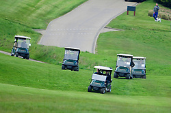 © Licensed to London News Pictures. 23/04/2016. Chandler's Cross, UK. President of The United States of America, BARAK OBAMA, playing golf with British prime minister DAVID CAMERON (both pictured front in buggy) at The Grove golf Course in Chandler's Cross, Hertfordshire. Photo credit: Ben Cawthra/LNP