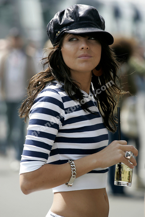 A beautiful pit-babe in the paddock after qualifying for the 2006 European Grand Prix at the Nurburgring. Photo: Grand Prix Photo