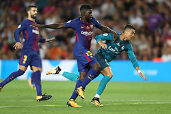 August 13, 2017 - Barcelona, Spain - Cristiano Ronaldo of Real Madrid duels for the ball with Samuel Umtiti of FC Barcelona before receiving a second yellow card and a red card during the Spanish Super Cup football match between FC Barcelona and Real Madrid on August 13, 2017 at Camp Nou stadium in Barcelona, Spain. (Credit Image: © Manuel Blondeau via ZUMA Wire)