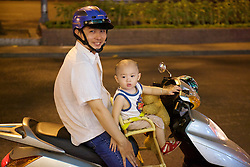 Man & Toddler On Scooter