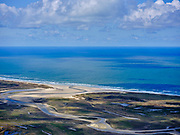 Nederland, Noord-Holland, Texel 07-05-2021;  De Slufter in het Nationaal Park Duinen van Texel, eigendom vanStaatsbosbeheer. Strandvlakte en eenkwelder, staatin open verbinding met deNoordzeeen wordt begrensd door stuifdijken en duinen. De Vlakte van de Slufter wordt ook Sluftervallei genoemd.<br /> De Slufter in the Duinen van Texel National Park. Beach plain and a salt marsh, has an open connection with the North Sea and is bordered by drift dikes and dunes. The Slufter Plain is also called the Slufter Valley.<br /> <br /> aerial photo (additional fee required)<br /> copyright © 2021 foto/photo Siebe Swart