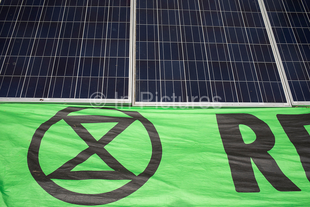 Extinction Rebellion solar panels as the camp starts to take shape in Waterloo Millennium Green on 17th July in London, England, United Kingdom. Extinction Rebellion is a climate change group started in 2018 and has gained a huge following of people committed to peaceful protests. These protests are highlighting that the government is not doing enough to avoid catastrophic climate change and to demand the government take radical action to save the planet.