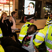 Arrests in progress in Oxford Circus. For up to ten days Extinction Rebellion activists occupied Waterloo Bridge, Parliament Square, Oxford Circus and Marble Arch disrupting traffic and 'normal life'. More than a thousand people were arrested before the police finally cleared the street and the International Rebellion was called to halt by the activists.  The environmental protest group Extinction Rebellion has called for civil disobedience and peaceful protest to force the British government to take drastic action on climate change. The group wants the government to tell the truth and admit that the impact of climate change is much more severe than they say and that action to mitigate catastrophic climate change is urgent.