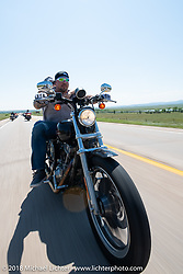Will Ramsey with Jessica Seidl on the Cycle Source Ride during the 78th annual Sturgis Motorcycle Rally. Sturgis, SD. USA. Wednesday August 8, 2018. Photography ©2018 Michael Lichter.