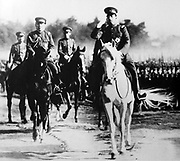 Hirohito (1901–1989) 124th Emperor of Japan (1926-1989). Emperor mounted on white horse at a review of troops, c1937.