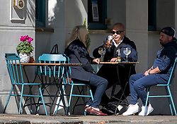 © Licensed to London News Pictures. 24/09/2020. London, UK. Members of the public are seen enjoying a drink at a pub in Primrose Hill, North London on the first day that pubs will be forced to close at 10pm in an attempt to prevent the spread of COVID-19. Chancellor Rishi Sunak today outlined a series of financial packages to help business through new lockdown measures. Photo credit: Ben Cawthra/LNP