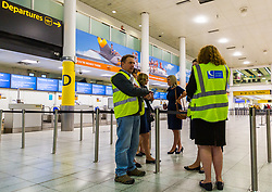 Civil Aviation Authority personnel are on hand to assist customers as travel company Thomas Cook ceases trading after failing to come to a deal with its bankers and creditors, leaving tens of thousands of travellers unable to depart on their holidays from South Terminal at Gatwick Airport, and a massive repatriation exercise to return holidaymakers from destinations all over the world. London Gatwick Airport, September 23 2019.
