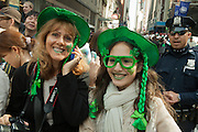 Parade watchers decked out in green.