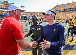 Sep 14, 2019; Morgantown, WV, USA; West Virginia Mountaineers head coach Neal Brown talks with North Carolina State Wolfpack head coach Dave Doeren after the game at Mountaineer Field at Milan Puskar Stadium. Mandatory Credit: Ben Queen-USA TODAY Sports