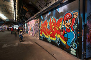 Spray painted street art and graffiti of Super Mario at the popular Leake Street Arches on 13th April 2021 in London, England, United Kingdom. Leake Street is a road tunnel in Lambeth, where graffiti is tolerated and encouraged regardless of the fact that it is against the law. The street is about 300 metres long, runs off York Road and under the platforms and tracks of Waterloo station.