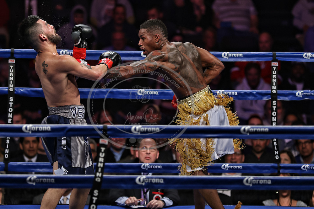 16 January 2015: Willie Monroe Jr. (R) punches Bryan Vera (L) during their NABA/NABO middleweight championship fight at the Turning Stone Resort Casino in Verona, NY.