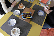 meeting at home with coffee and cakes