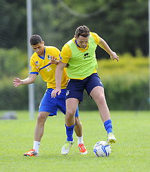 Bristol Rovers' Alefe Santos battles for the ball with Bristol Rovers' Tom Parkes - Photo mandatory by-line: Joe Meredith/JMP - Tel: Mobile: 07966 386802 24/06/2013 - SPORT - FOOTBALL - Bristol -  Bristol Rovers - Pre Season Training - Npower League Two