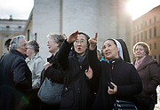 Nuns from Korea discover the smoke stack which will tell if there is a new Pope in St. Peter's Square during the first day of conclave and the selection of the new Pope in Vatican City, March 12, 2013. Photograph by Todd Korol