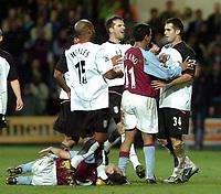 Fotball<br /> Premier League 2003/2004<br /> Picture: Henry Browne.<br /> Date: 11/02/2004.<br /> Fulham v Aston Villa FA Barclaycard Premiership.<br /> <br /> Players square up after Carlos Bocanegra's challenge on Villa's Mark Delaney.