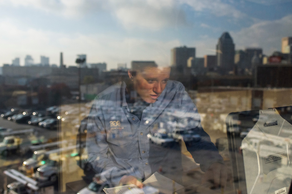 Baltimore, Maryland - November 12, 2014: Courtney Lupinek, a utility trainee/technician with Baltimore Gas Electric finds addresses for morning routes on her laptop at the BGE Front Street location offices. <br /> <br /> CREDIT: Matt Roth for The New York Times<br /> Assignment ID: 30166854A
