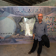 """VENICE, ITALY - JUNE 02:  Iraqi artist Walid Siti poses in front of his work """"Beauty spot"""" at the Iraq pavillion on June 2, 2011 in Venice, Italy. This year's Biennale is the 54th edition and will run from June 4th until 27 November."""