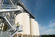 A construction worker walks up the scaffolding outside the Puris pea protein processing facility in Dawson, Minnesota, on Tuesday, June 8, 2021.