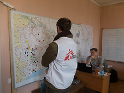 Loïc Jaeger, Deputy Head of Mission for MSF in Ukraine consults a map of MSF eastern Ukraine projects and activities in the MSF office in Kurakhove close to the frontline with the territory of the Donetsk People's Republic.