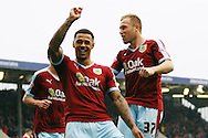 Andre Gray of Burnley (c) celebrates with his team mate Scott Arfield after scoring his teams 1st goal from the penalty spot. Skybet football league Championship match, Burnley v Huddersfield Town at Turf Moor in Burnley ,Lancs on Saturday 31st October 2015.<br /> pic by Chris Stading, Andrew Orchard sports photography.