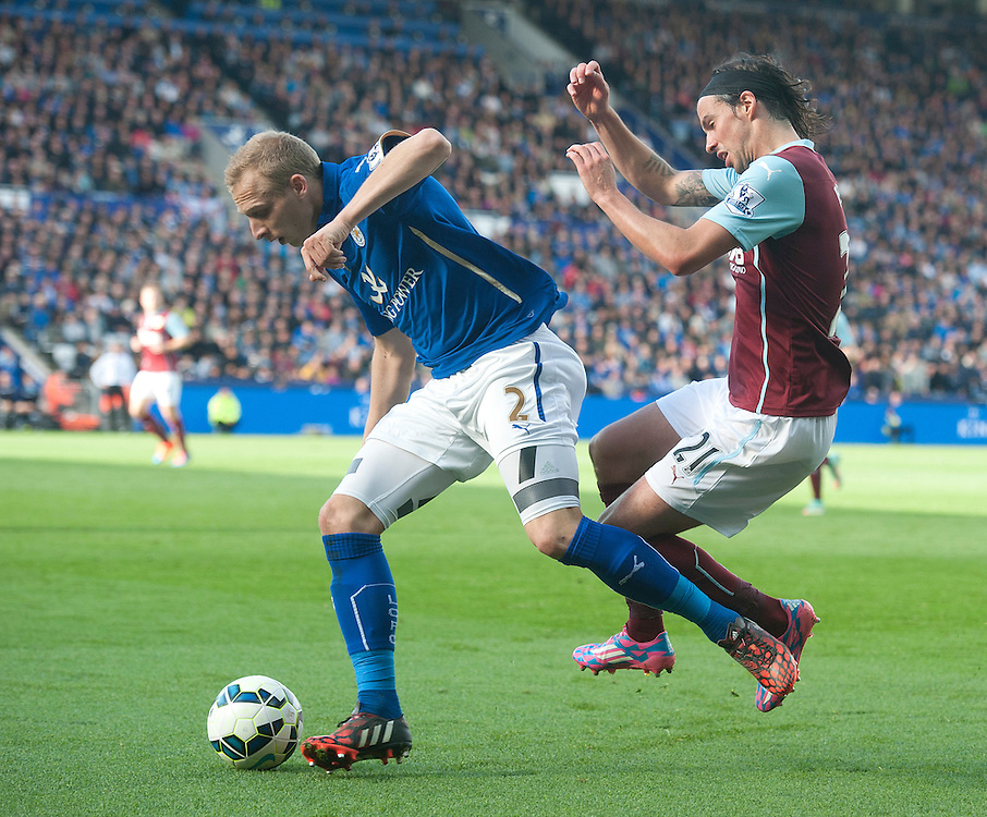 Burnley's George Boyd battles with Leicester City's Ritchie De Laet<br /> <br /> Photographer Stephen White/CameraSport<br /> <br /> Football - Barclays Premiership - Leicester City v Burnley - Saturday 04th October 2014 - King Power Stadium - Leicester<br /> <br /> © CameraSport - 43 Linden Ave. Countesthorpe. Leicester. England. LE8 5PG - Tel: +44 (0) 116 277 4147 - admin@camerasport.com - www.camerasport.com