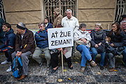 """Supporters of Czech President Milos Zeman holding a sign where is written """"Long live Zeman"""" during an anti-Islam rally in Prague. Czech Republic celebrates that day the 26th anniversary of the Velvet Revolution which took place in 1989."""