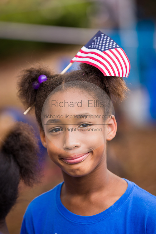 A young girl wears an American flag in her hair during the Daniel Island Independence Day parade July 3, 2015 in Charleston, South Carolina.