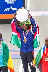 ING New York CIty Marathon: Geoffrey Mutai, Kenya, hoist the winner's platter on podium after winning race