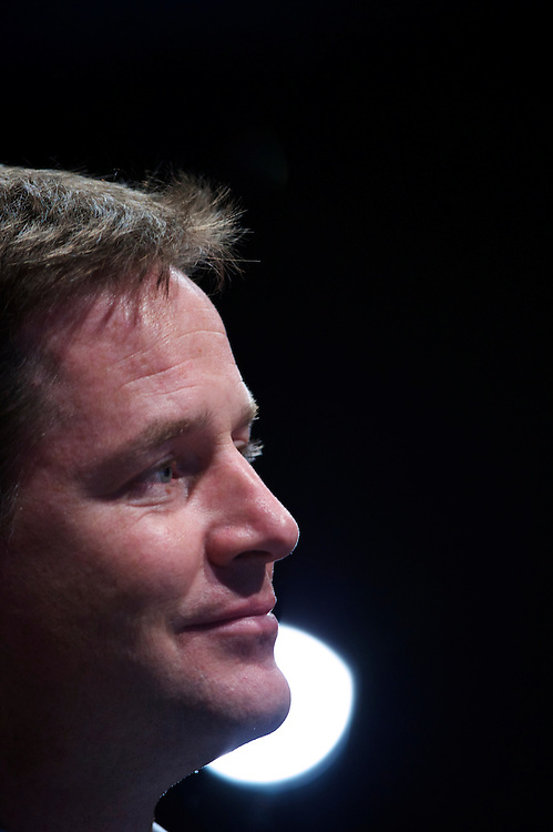 Deputy Prime Minister Nick Clegg (centre) listens during Welsh Liberal Democrat leader Kirsty Williams's speech to delegates attending the Liberal Democrat Autumn Conference in Liverpool on 19 September 2010.  This was the first party conference since the government coalition with the tories.