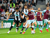 Football - 2021 / 2022  EFL Carabao Cup - Round Two - Newcastle United vs Burnley - St Jame's Park - Wednesday 25th August 2021<br /> <br /> Josh Brownhill of Burnley vies with Jamal Lewis of Newcastle United<br /> <br /> Credit: COLORSPORT/Bruce White