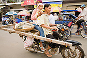 14 MARCH 2006 - PHNOM PENH, CAMBODIA: Motorcycles used for family transportation in Phnom Penh, Cambodia. As the Cambodian economy continues to improve, consumers have been buying motorcycles to replace their bicycles.  Photo by Jack Kurtz / ZUMA Press