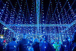 © Licensed to London News Pictures. 11/12/2019. The first day of the Submergence lightshow by Squidsoup in Bristol's Millennium Square for Christmas. Submergence is an immersive walkthrough lightshow, where the audience can walk through the hanging lights. It will remain in the square for Christmas and New Year. Photo credit: Simon Chapman/LNP.