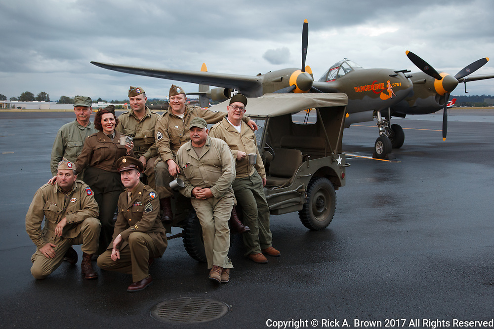 Living history group with Erickson Aircraft Collection's P-38 Lightning at Warbirds Over the West.