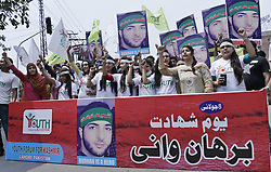 July 8, 2017 - Lahore, Punjab, Pakistan - Pakistani members of Youth Forum for Kashmir hold placards chant slogans against Indian during a demonstration  Burhan Wani rally in connection with first death anniversary of the Hizbul Mujahideen commander Burhan Wani in Lahore on July 08,2017.Burhan Muzaffar Wani, also known as Burhan Wani, was a commander of Hizbul Mujahideen,He was popular among the Kashmiris due to his activity on social media where he advocated against Indian rule in Kashmir. He was killed in an encounter with the Indian security forces. (Credit Image: © Rana Sajid Hussain/Pacific Press via ZUMA Wire)