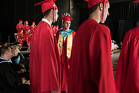 """Wearing his crown Jared Clough """"Mr. BHS"""" along with fellow graduates line up to receive thier diplomas from Belmont High School during the commencement at Meadowbrook Pavillion Sunday morning.  (Karen Bobotas/for the Laconia Daily Sun)"""