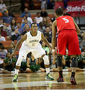 Kendal Harris (5) of Richardson Berkner defends against Andrew Harrison (5) of Fort Bend Travis during the UIL Conference 5A semifinals at the Frank Erwin Center in Austin on Friday, March 8, 2013. (Cooper Neill/The Dallas Morning News)