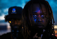July 10, 2016 - Javaris DeJuan Marable, 26, faces flashing blue lights from Memphis Police Department's squad cars during a Black Lives Matter protest in Memphis on Sunday. Over 1,000 people demonstrated on the I-240 bridge in response to the recent shooting deaths of Alton Sterling and Philando Castile, two African-American men who died at the hands of law enforcement. (Yalonda M. James/The Commercial Appeal)