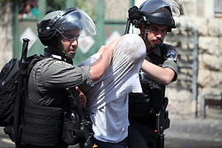 August 20, 2017 - Jerusalem, Jerusalem, Palestinian Territory - Israeli security forces detain a Palestinian protester during clashes following Friday prayer outside Jerusalem's Old City on July 21, 2017, after Israeli police barred men under 50 from entering the Old City for Friday Muslim prayers as tensions rose and protests erupted over new security measures at the highly sensitive Al-Aqsa mosque compound. The ban came after Israeli ministers decided not to order the removal of metal detectors erected at entrances to the Al-Aqsa mosque compound, known to Jews as the Temple Mount, following an attack nearby a week ago that killed two policemen  (Credit Image: © Amir Abed Rabbo/APA Images via ZUMA Wire)