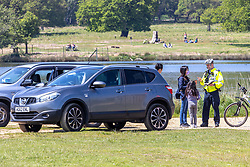 Licensed to London News Pictures. 30/05/2021. London, UK. Drivers get caught out by the police for parking outside of the car parks after they became full as the public head out in the sunshine for a Sunday picnic in Richmond Park, southwest London this afternoon. The Met Office have forecast warm weather and sunshine for the South East and London over the Bank Holiday weekend with temperatures predicted to hit up to 24c for Bank Holiday Monday. Photo credit: Alex Lentati/LNP