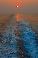 Sunset looking aft on the M/V Explorer. Image taken with a Nikon D3x and 70-300 mm VR lens (ISO 100, 75 mm, f/9, 1/200 sec). Raw image processed with Capture One Pro 6, NIK Color Efex Pro Contrast, NIK Define 2, and converted to JPG/sRGB with Photoshop CS5.