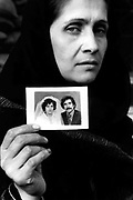 Razia and her wedding photo. Her husband disappeared in 1992 when he went to teach at the university. Razia has worked as a caretaker ever since in order to provide for her children.