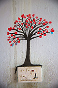 A blossoming tree painted above an electrical power switch in a house on the 6th of March 2020 Lamjung District in Gandaki Pradesh, Nepal